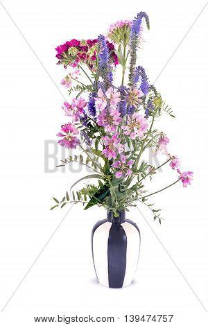 Bouquet of wild flowers in striped vase