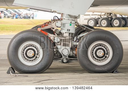 FARNBOROUGH, UK - JULY 15: Closeup section of an Airbus A350 undercarriage on the taxiway at an aviation event in Farnborough, UK on July 15, 2016