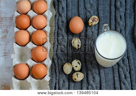 Eggs In A Cardboard Tray With A Jar Of Hot Milk