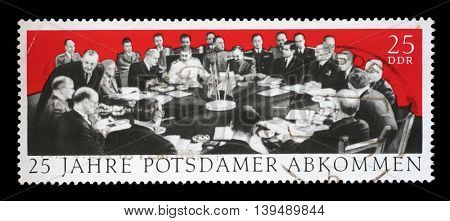 ZAGREB, CROATIA - JULY 03: A stamp printed in GDR dedicate 25th anniv. of the Potsdam Agreement, Churchill, Harry S. Truman and Stalin, circa 1970, on July 03, 2014, Zagreb, Croatia