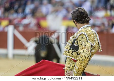 Jaen SPAIN - October 17 2008: Spanish bullfighter Cesar Jimenez in the alley waiting at the paseillo or initial parade bullfight at Jaen bullring Spain