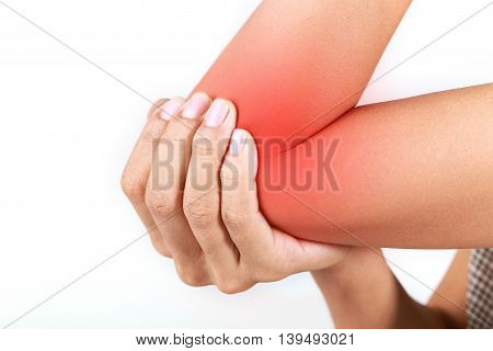 Elbow pain.Female holding hand to spot of elbow pain.