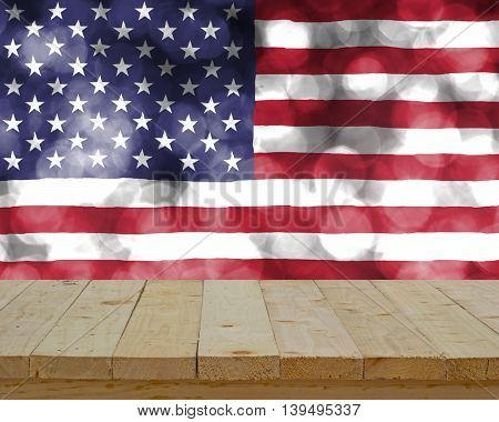 wood table top on blur abstract USA flag on buble bokeh light background - can use to display or montage on product or concept to celebrate of indipendent day in USA