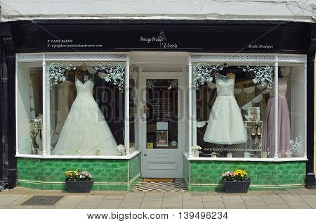 St Ives, Cambridgeshire, England - July 20, 2016: Bridal Shop Window with dresses on show.