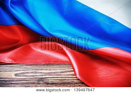 Russian flag on a wooden table. vignetting for artistic effect