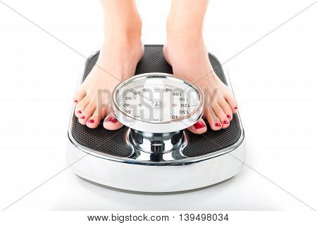 Diet and weight, young woman standing on a scale