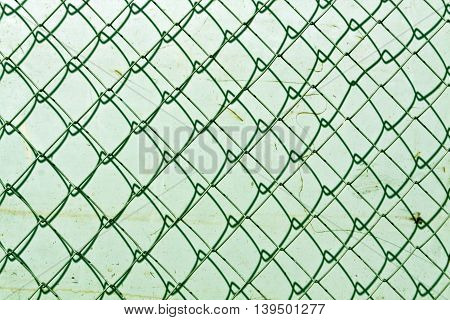 Abstract Chain Link Fence Texture Against Grungy Color Wall.