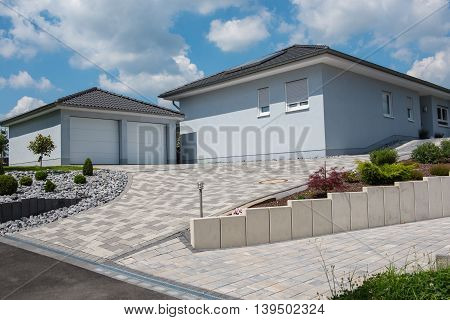 beautiful light blue prefabricated house with double garage