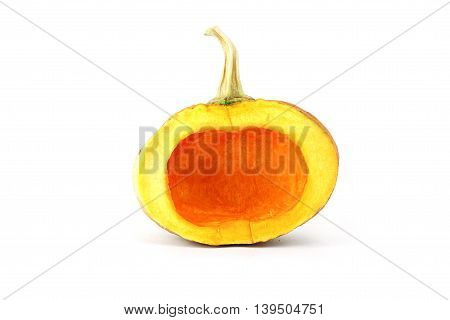Small piece of half seedless yellow asian pumpkin on white background. Object side view.