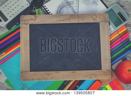 Empty Chalkboard with copy space and school supplies, retro toned