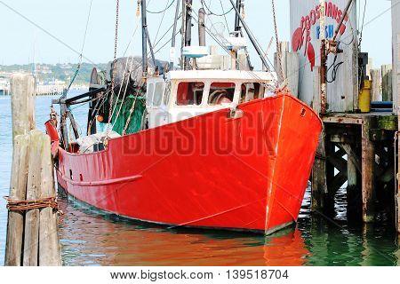 Fishing boat docks for the day in Montauk, NY