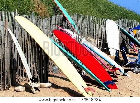 Surfboards rest against a fence in Ditch Plains Montauk, NY