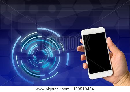 Woman hand holding smartphone against digital blue background with copy space