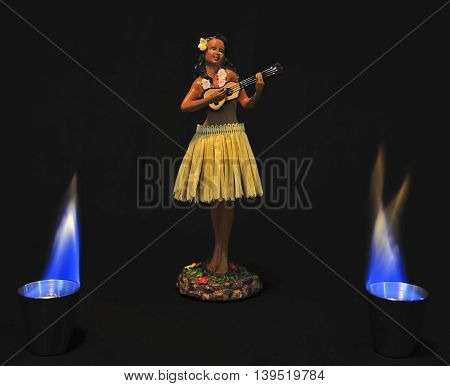 This is a  photo of a hula girl doll with flames