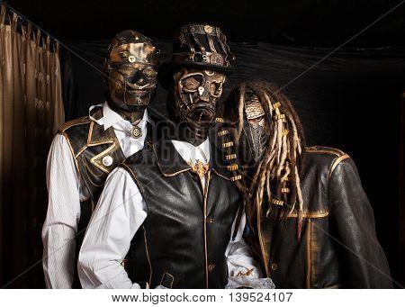 Three Actors In Cyborg Costumes