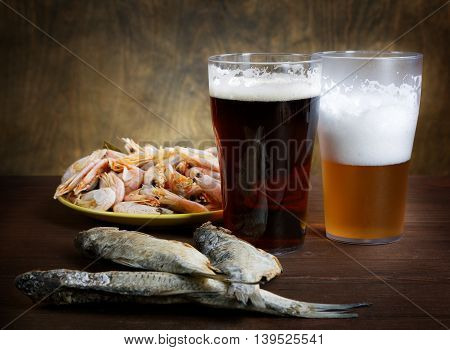 Two Glasses Of Beer With Dried Fish And Crayfish