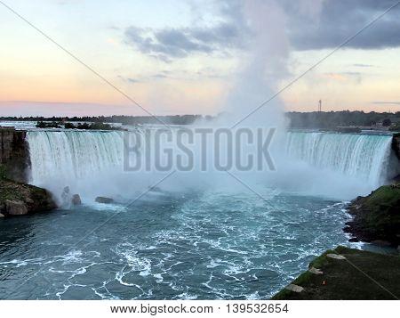 View of Canadian Niagara Falls evening from Niagara Falls city Ontario, Canada