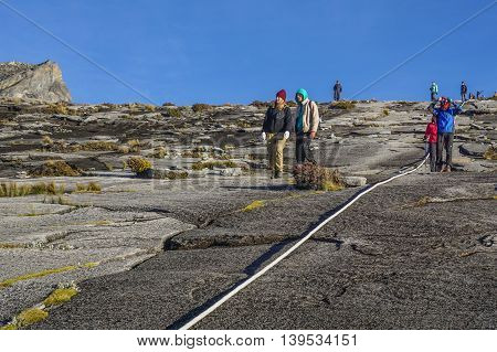 Ranau,Sabah,Borneo-March 13,2016:Group of climbers moving down to Laban Rata after succesfully completed conquering the summit of mountain Kinabalu.