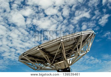 satellite dish  with blue sky background and cloudy