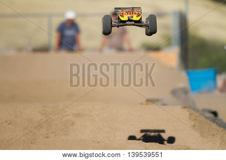 BOISE IDAHO-JULY 16 2016: Truggy flying through the air after a big jump