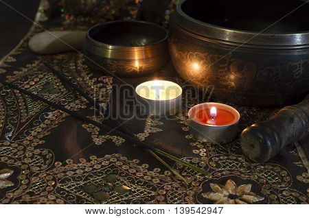 Still life with tibet singing bowls in candle light