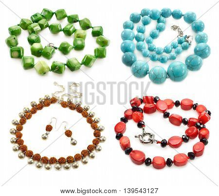 Set with circlets and necklaces of semiprecious stones isolated on white