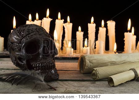 Scary skull with candles and paper scrolls, Halloween concept