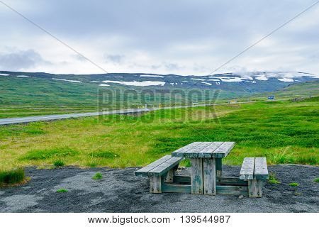 Picnic Table And Landscape Near The Isafjordur Fjord