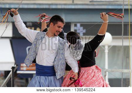 ZAGREB, CROATIA - JULY 22: Members of folk group Escola de ball de bot Calabruix from Mallorca, Spain during the 50th International Folklore Festival in center of Zagreb, Croatia on July 22, 2016
