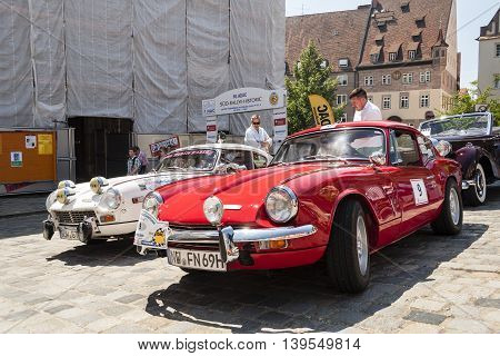 Nurnberg Bavaria / Germany - July 19th 2014: red Triumph GT6 displayed vintage car at Sud - Rallye- Historic event in Nurnberg