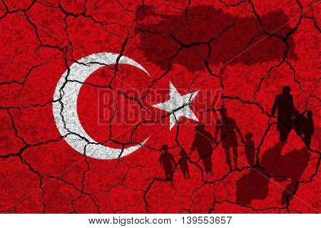 Turkey flag and refugees on a white stone wall