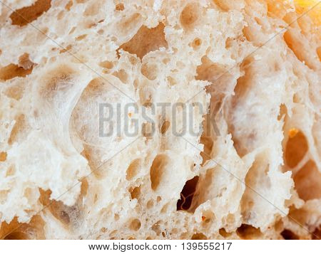 close up shot of white sourdough bread slice. Macro of bread slice texture. Tasty fresh bread, close up for background