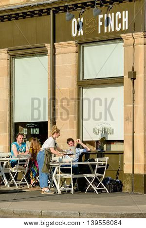 GLASGOW SCOTLAND - JULY 21 2016: Food served outside at the Ox and Finch restaurant in Sauchiehall Street in the west-end of Glasgow.