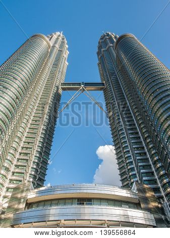 KUALA LUMPUR MALAYSIA - FEB 29: Petronas Twin Towers the famous landmark of Malaysia on February 29 2016 in Kuala Lumpur Malaysia. Petronas Twin Towers are twin skyscrapers and were the tallest buildings in the world during 1998-2004.