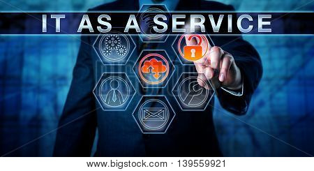 Business manager is touching IT AS A SERVICE on an interactive control monitor. Information technology concept for value creation through running enterprise IT like a business entity. Close up.