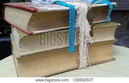 Vintage old collection book stack with fabric and keys