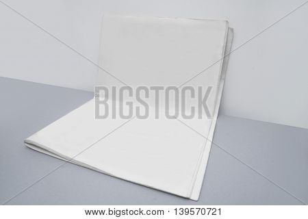 Blank newspaper cover template isolated on grey background with clipping path ready for your artwork