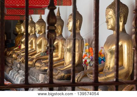 Gold Buddha Statue In Public Temple In Thailand. Row Of Buddha Imanges In Different Posture.