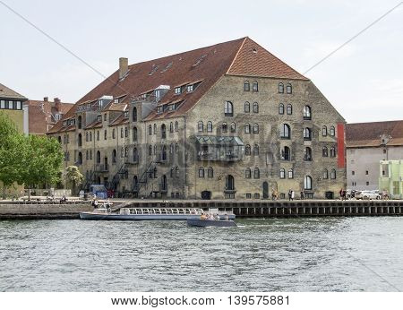 waterside scenery including a old historic building in Copenhagen the capital city of Denmark