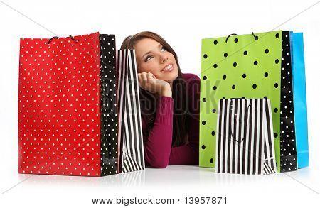 Mujer hermosa, joven, con coloridas bolsas