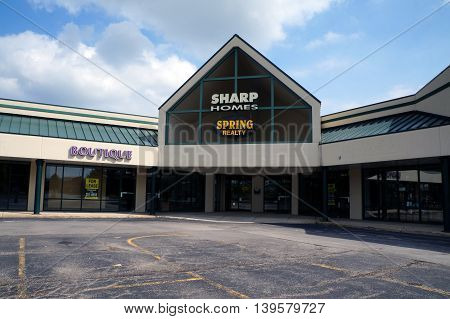 SHOREWOOD, ILLINOIS / UNITED STATES - AUGUST 30, 2015: One may buy or sell real estate with the assistance of realtors at Sharp Homes Spring Realty, in a Shorewood strip mall.
