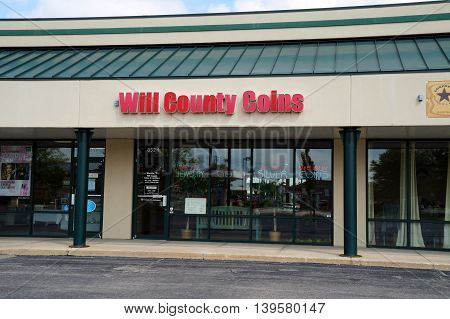 SHOREWOOD, ILLINOIS / UNITED STATES - AUGUST 30, 2015: Will County Coins & Currency buys, sells, and appraises coins, jewelry gold and silver, in a Shorewood strip mall.