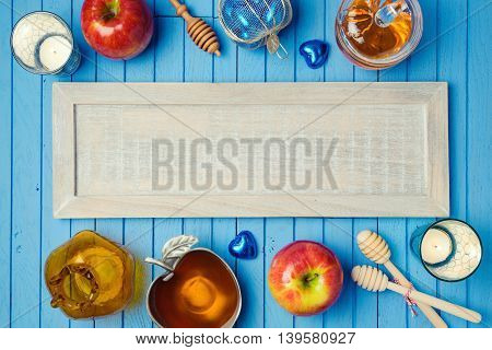 Jewish holiday Rosh Hashana background with wooden board honey and apples on table. View from above. Flat lay