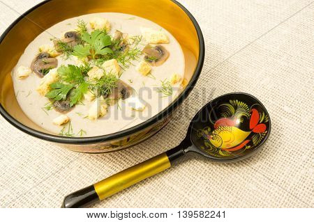 Cream soup with mushrooms herbs and croutons