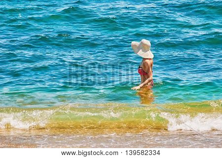 Woman in White Hat Bathe in the Black Sea