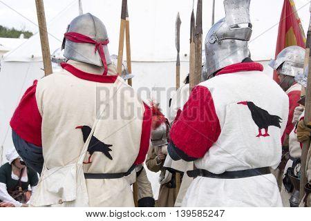 Tewkesbury, UK-July 17, 2015: Raven insignia on jerkin costume of two reenactors on 17 July 2015 at Tewkesbury Medieval Festival