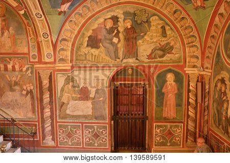 July 17 2016-Benedictine Monastery of Subiaco in the Lazio-Italy-Architecture church ornaments paintings and frescoes that tell the life of St. Benedict in the crypt of a monastery Benedictine