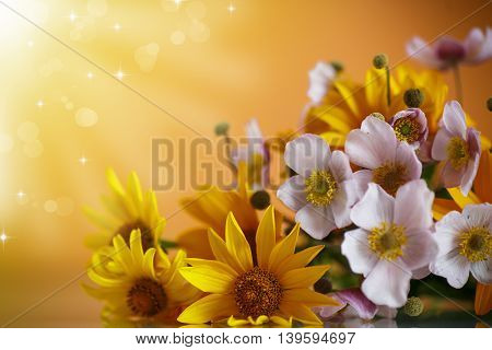 Summer bouquet of yellow daisies on an orange background
