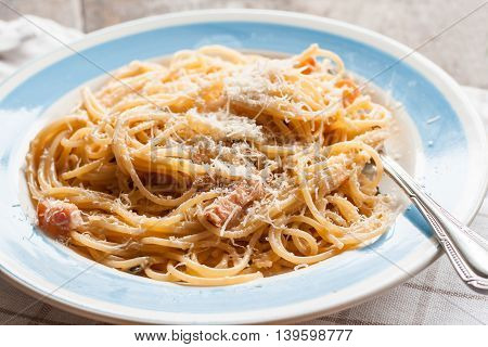 pasta carbonara close-up on wooden a background.