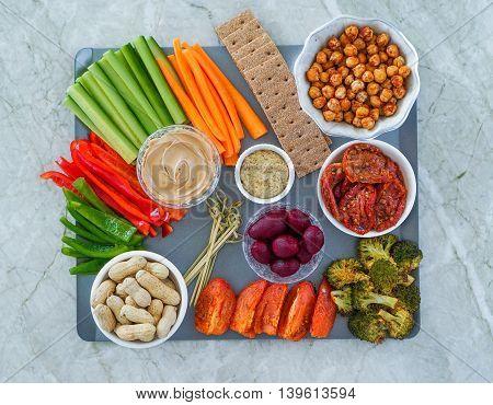 Vegetable vegan Crudites, nuts and Dips/ vegetable platter, healthy eating